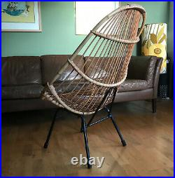 50s bamboo lounge cocktail chair. Vintage mid-century atomic rattan, cane chair